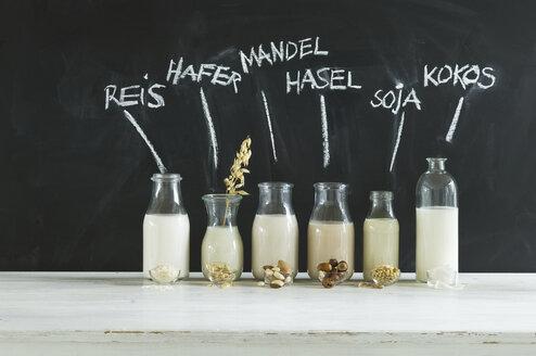 Glass bottles of various vegan milks - ASF06048