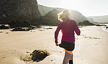 France, Crozon peninsula, teenage girl running on the beach - UUF08617
