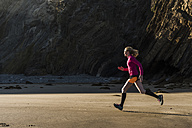 France, Crozon peninsula, teenage girl running on the beach - UUF08620