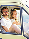 Happy couple traveling in a camper - LAF01768