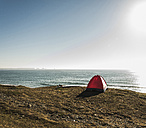 Red tent and surfboard at seaside - UUF08744