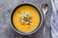 Bowl of sweet potato coconut soup with ginger, parsnip, leek, sprout and almond - SARF02994