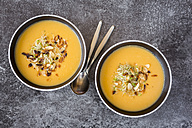 Bowl of sweet potato coconut soup with ginger, parsnip, leek, sprout and almond - SARF02997