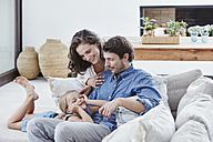 Family with daughter relaxing on couch - RORF00335