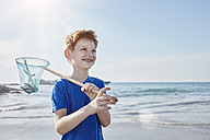 Boy with dip net at the sea - RORF00353