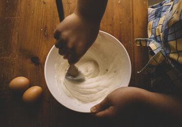Girl stirring batter for cake - LOMF00413