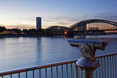 Germany, Cologne, view to KoelnTriangle and Hohenzollern Bridge at evening twilight - GFF00838