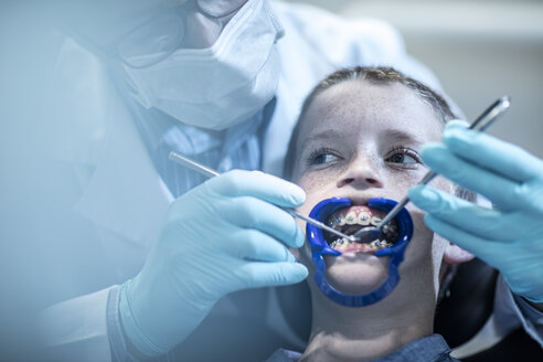 Boy in dental surgery receiving orthodontic treatment - ZEF10628