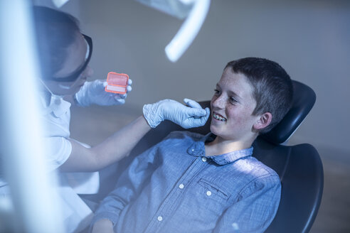 Boy in dental surgery receiving orthodontic treatment - ZEF10643