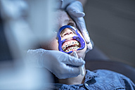 Boy in dental surgery receiving orthodontic treatment - ZEF10646