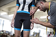 Tailor measuring sportswear worn by model - ZEF10700