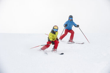 Father and son skiing together - HHF05452