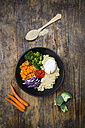 Lunch bowl of quinoa, red cabbage, carrots, roasted chickpeas, broccoli, poached egg and ajvar - LVF05482