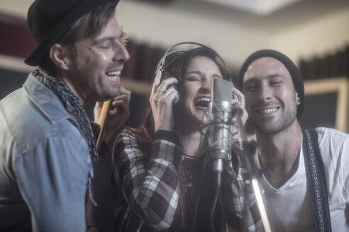Three singers at recording studio - ZEF10735