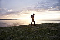 Iceland, man hiking at twilight - RBF05217