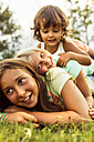 Three girls playing together on a meadow - MGOF02540
