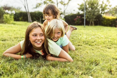 Three girls having fun together on a meadow - MGOF02552