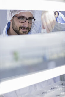 Scientist working in lab wearing protective clothing - ZEF10852