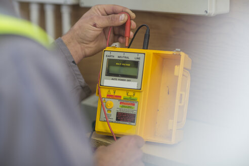 Electrician working with voltmeter - ZEF10901