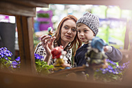 Mother and son shopping at garden centre - ZEF10976