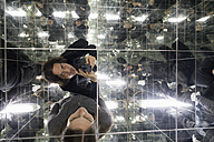 Couple taking selfies in a house of mirrors - NDF00607