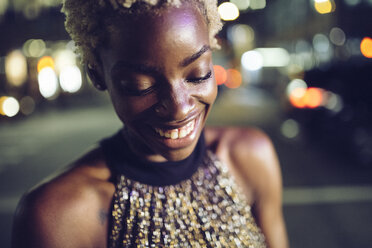 Portrait of happy young woman at night - GIOF01563