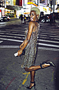 USA, New York City, extravagant young woman on Times Square at night - GIOF01584