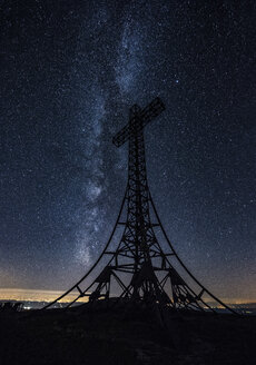 Italy, Marche, silhouette of summit cross on Monte Catria at night - LOMF00438