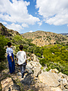 Oman, Jabal Akhdar, Women looking at the abandoned village Wadi Bani Habin - AMF05037