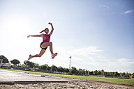 Female long jumper mid-air - ABZF01373