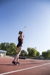 Female pole vaulter preparing - ABZF01388