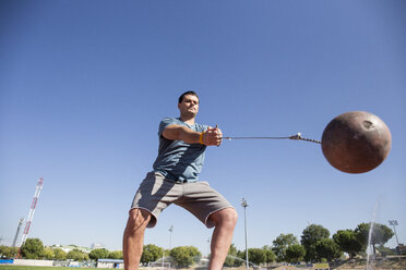 Athlete performing a hammer throw - ABZF01406