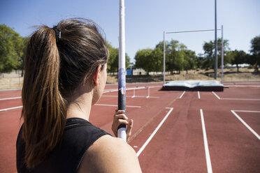 Female pole vaulter preparing - ABZF01409