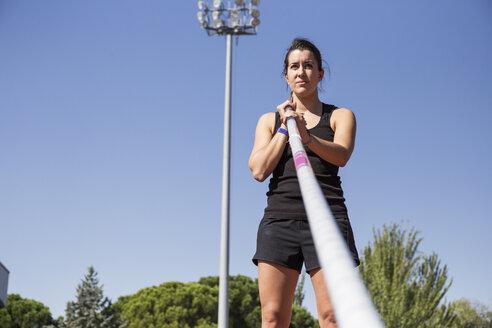 Female pole vaulter preparing - ABZF01412