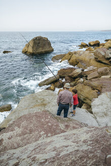 Grandfather and grandson fishing together at the sea - DAPF00419