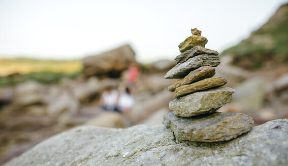 Stack of stone with blurred people in background - DAPF00449