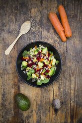 Bowl of autumnal salad with lettuce, carrots, avocado, beetroot, seeds, pomegranate and quinoa - LVF05490