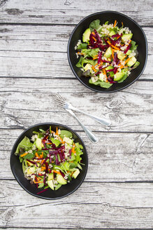 Two bowls of autumnal salad with lettuce, carrots, avocado, beetroot,  seeds, pomegranate and quinoa - LVF05493