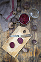 Whole and sliced beetroots and preserving jar of pickled beetroots - LVF05497