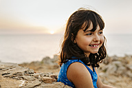 Portrait of happy little girl near the sea at sunset - MGOF02571