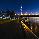 Germany, Duesseldorf, view to  lighted Rheinknie-Bruecke and television tower by night - KRPF01915