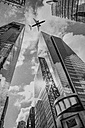 USA, New York City, skyscrapers seen from below with overflying airplane - ZEF11123