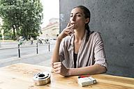 Young woman smoking - TAMF00734