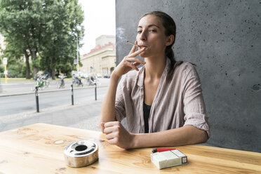 Young woman smoking - TAMF00734