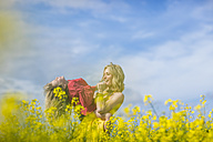Mother and little daughter having fun together in rape field - ZEF11127