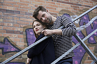 Portrait of couple on stairs outdoors - SUF00114