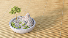 Tree and mountains in zen bowl on bamboo mat - AHUF00278