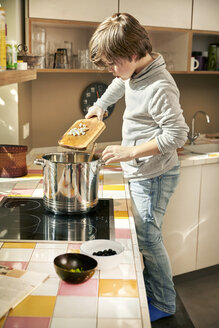 Little boy cooking in the kitchen - TSFF00136