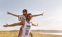 Couple in love having fun near the coast - MGOF02581