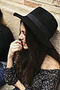 Smiling young woman wearing black hat - EBSF01857